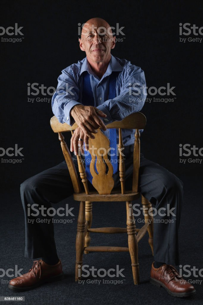 Man in his 50s wearing a suit stock photo