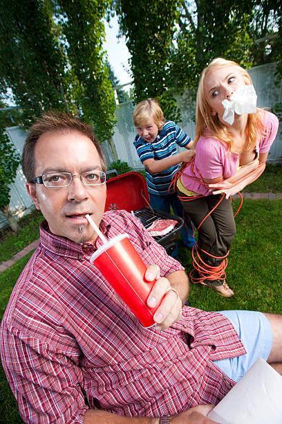 Man in his backyard stock photo