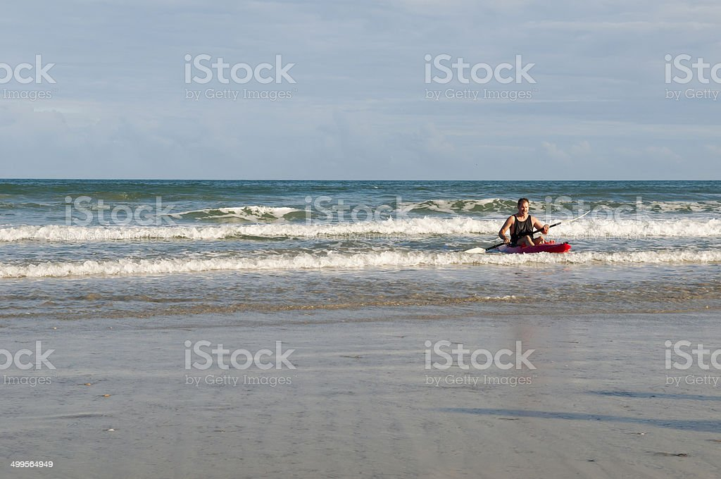 Man in his sixties kayaking at the beach in Florida stock photo