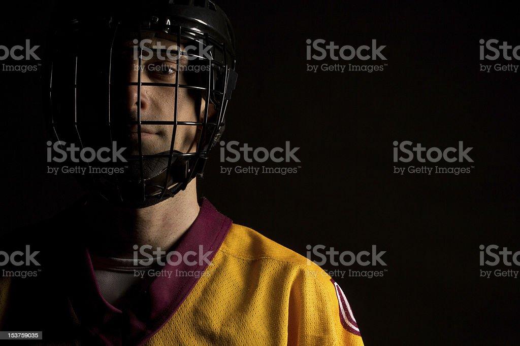 man in hockey helmet stock photo