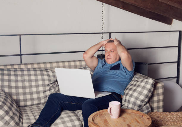 man in home watching movie on laptop - free images for downloads stock photos and pictures