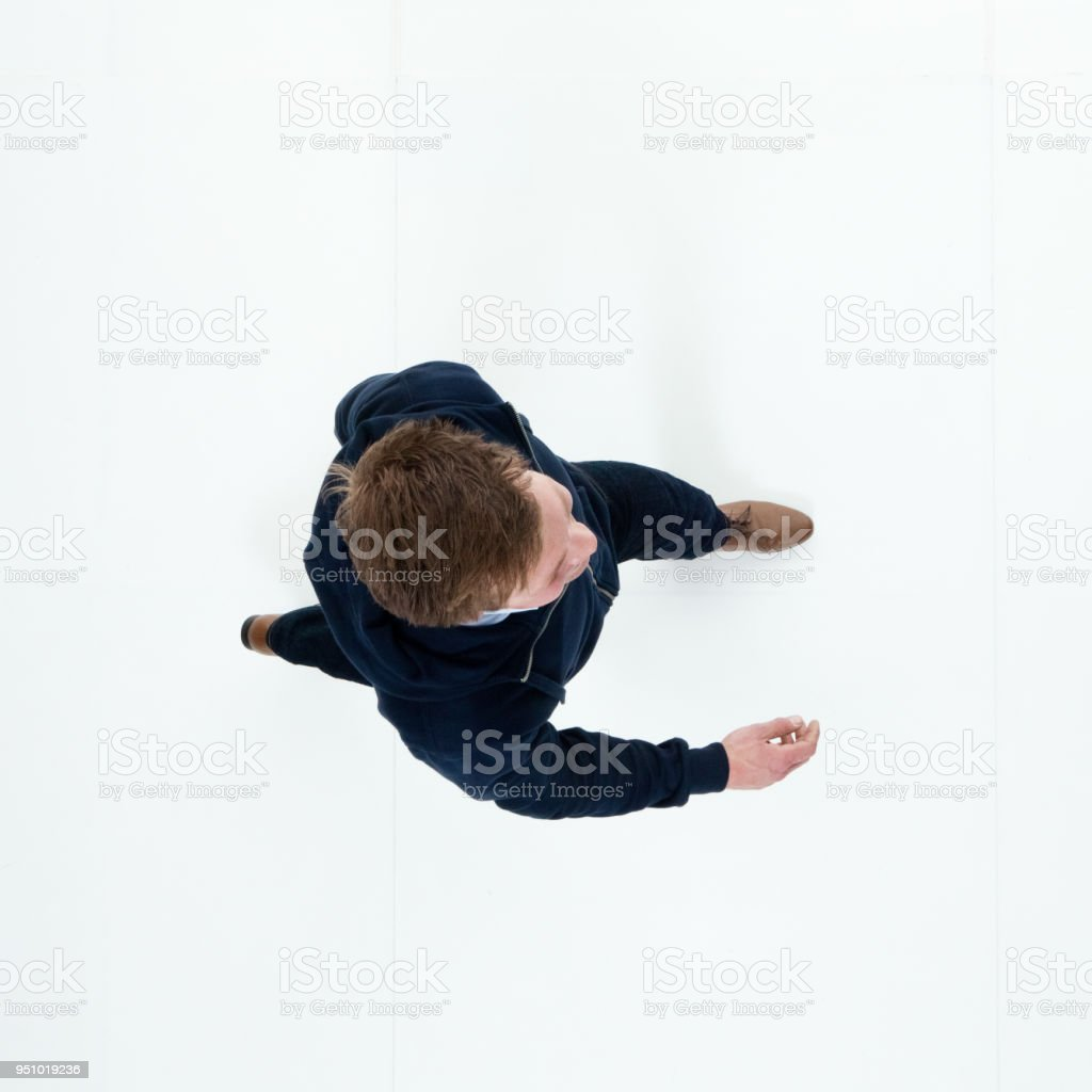 Man in hooded jacket walking stock photo