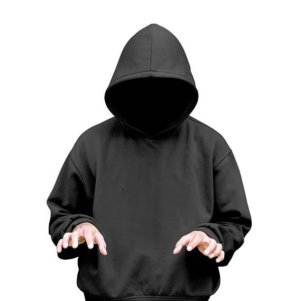Man in hoodie typing something stock photo