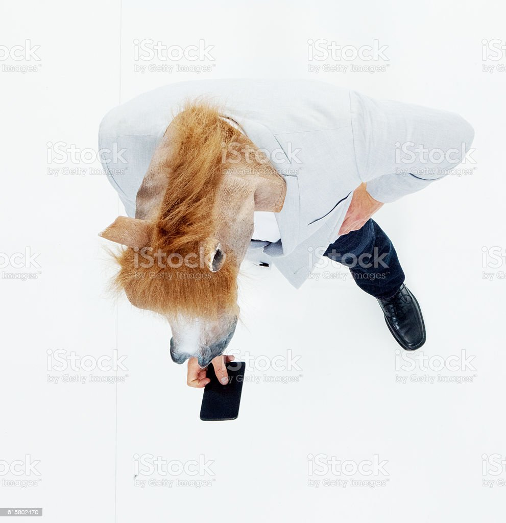 Man in horse costume and using phone royalty-free stock photo & Man In Horse Costume And Using Phone Stock Photo u0026 More Pictures of ...