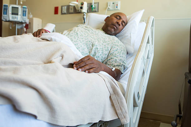 Man in hospital bed Man in hospital bed patience stock pictures, royalty-free photos & images