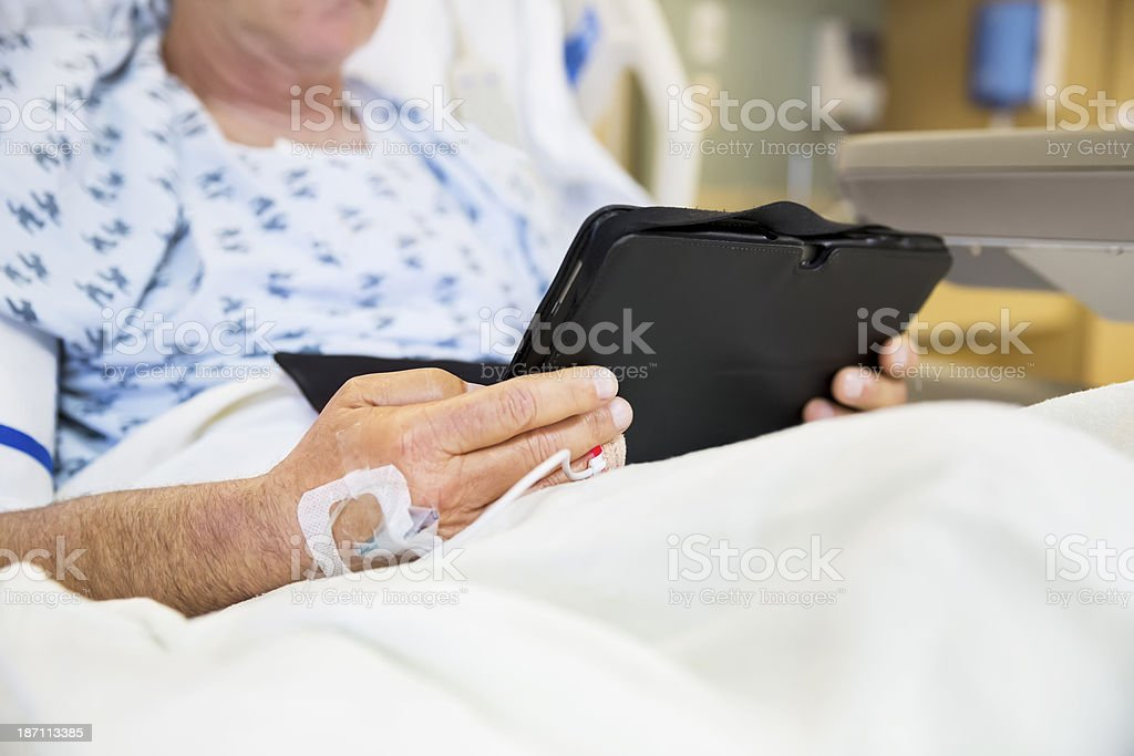 Man in hospital uses his lap top royalty-free stock photo