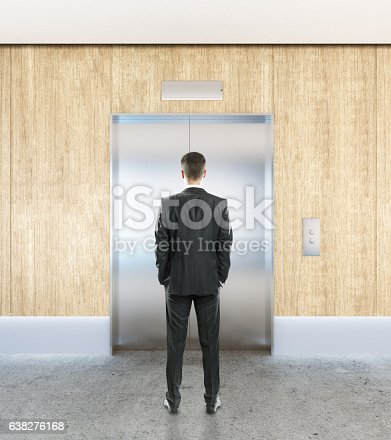 638591126 istock photo Man in interior with elevator 638276168