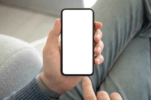 Mann in Jeans halten Telefon mit einem isolierten Bildschirm – Foto