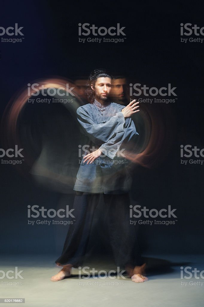 Man in kimono excercising Martial Arts stock photo