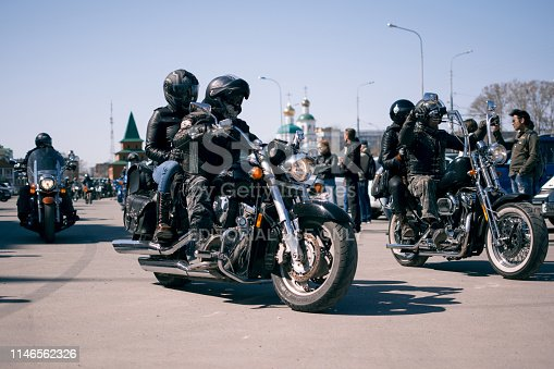 Yoshkar-Ola, Russia - May 2019 A man in leather clothes on a motorcycle participates in a parade