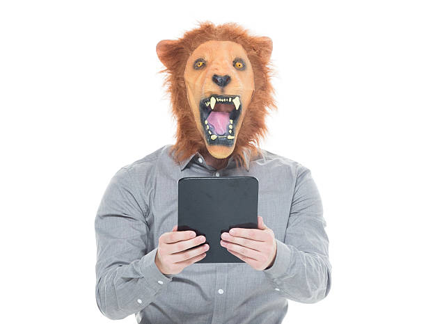 Man in lion costume and using tablet picture id639843460?b=1&k=6&m=639843460&s=612x612&w=0&h=tdnmncf1bmbloio4bte2sod9j4pvcmxgocsn60etbp8=