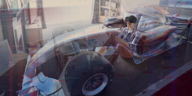 Man In Living Room Driving a Virtual Reality Racing Car stock photo