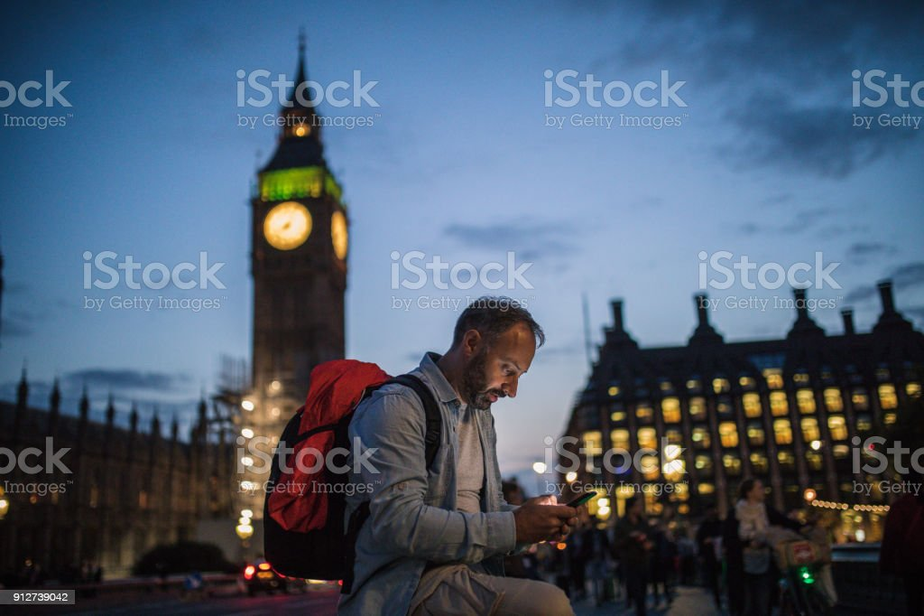 Man in London texting stock photo
