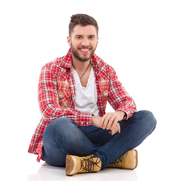 man in lumberjack shirt sitting - sitting on floor stock photos and pictures