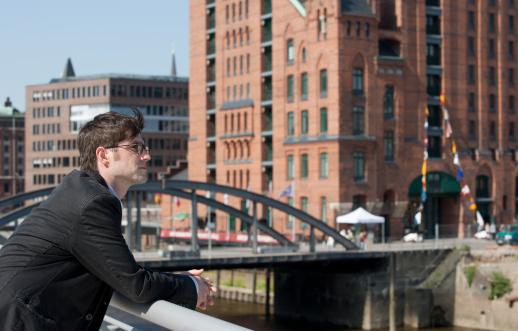 Man in Magdeburger Hafen of Hamburg