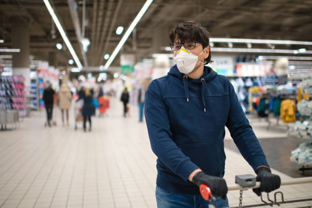Man in mask and rubber gloves in a supermarket