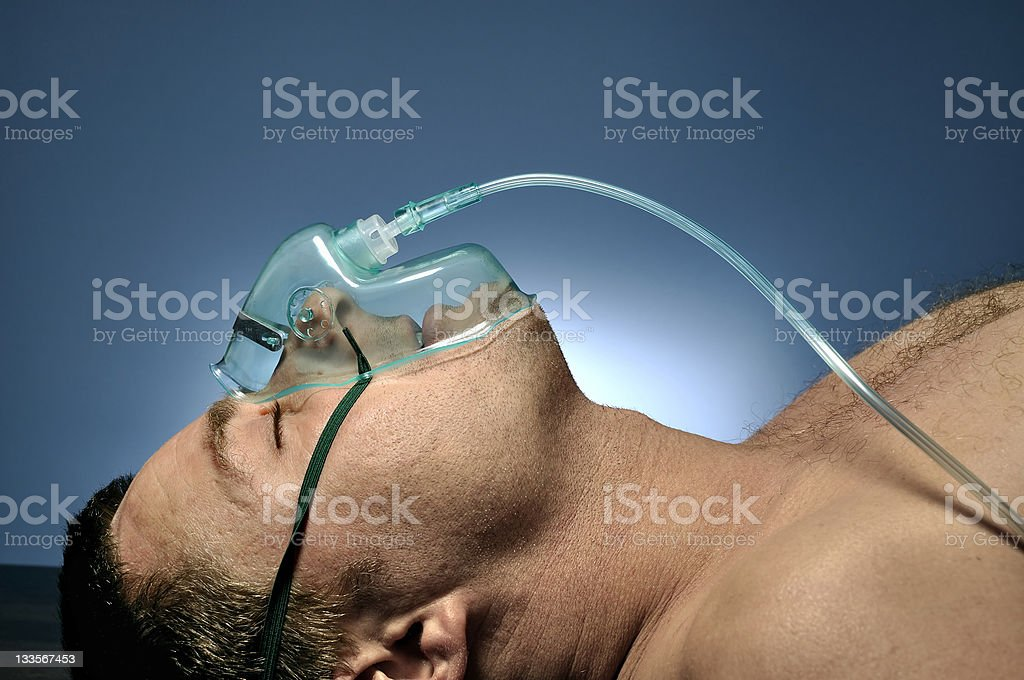 Man in mask oxygen. stock photo
