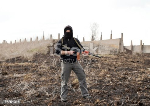 istock Man in mask with gun 177294316