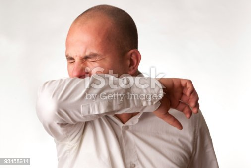 istock Man in mid cough demonstrating proper hygienic procedure 93458614