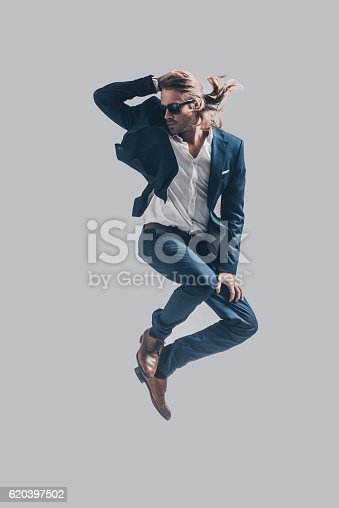 664626542 istock photo Man in mid-air. 620397502