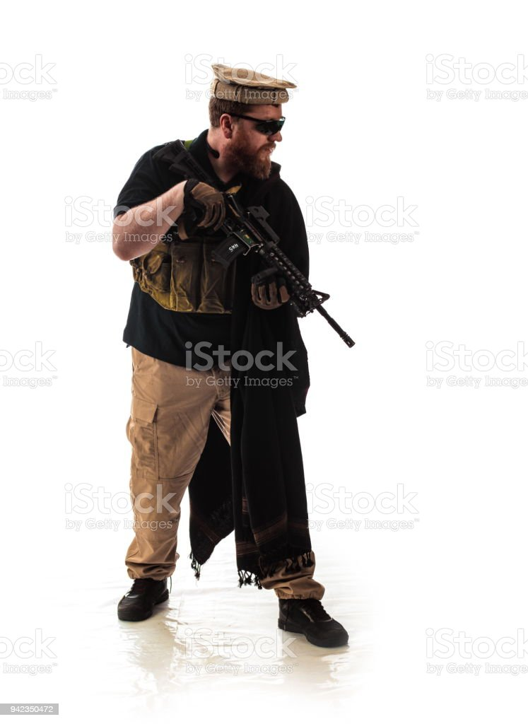 man in military outfit CIA agent, which is similar to the clothing of a warrior Mujahedin, in modern times on a white background stock photo