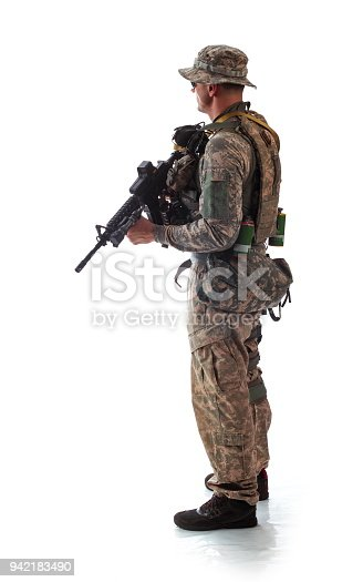 istock man in military outfit of the American trooper in modern times on a white background in studio 942183490