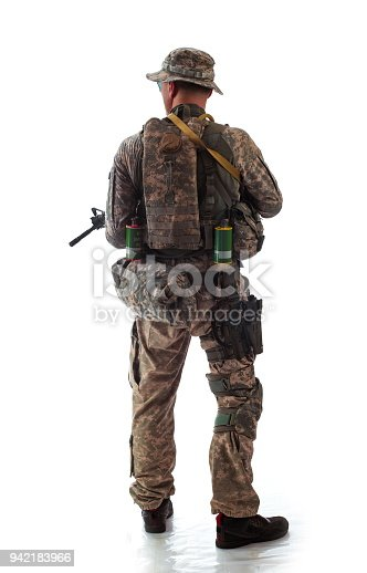 istock man in military outfit of the American trooper in modern times on a white background in studio 942183966
