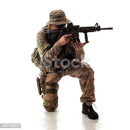 istock man in military outfit of the American trooper in modern times on a white background in studio 942184072