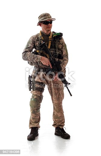 istock man in military outfit of the American trooper in modern times on a white background in studio 942184098