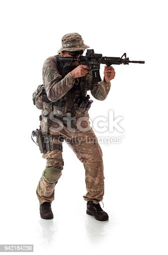 istock man in military outfit of the American trooper in modern times on a white background in studio 942184236