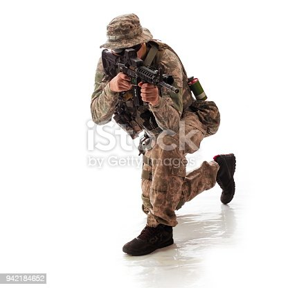 istock man in military outfit of the American trooper in modern times on a white background in studio 942184652