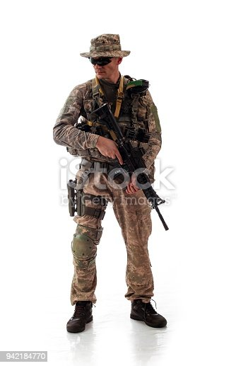 istock man in military outfit of the American trooper in modern times on a white background in studio 942184770