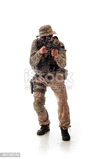 istock man in military outfit of the American trooper in modern times on a white background in studio 942185150