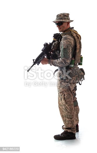istock man in military outfit of the American trooper in modern times on a white background in studio 942185220