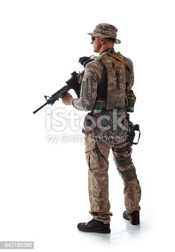 istock man in military outfit of the American trooper in modern times on a white background in studio 942185392