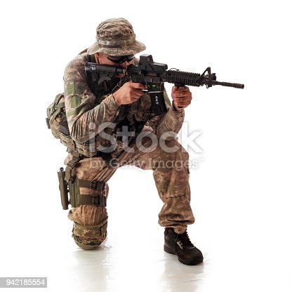 istock man in military outfit of the American trooper in modern times on a white background in studio 942185554