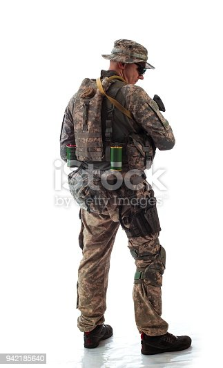 istock man in military outfit of the American trooper in modern times on a white background in studio 942185640