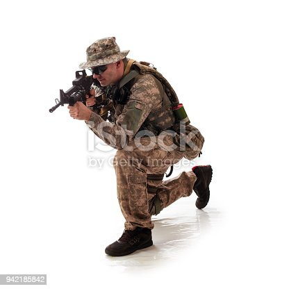 istock man in military outfit of the American trooper in modern times on a white background in studio 942185842