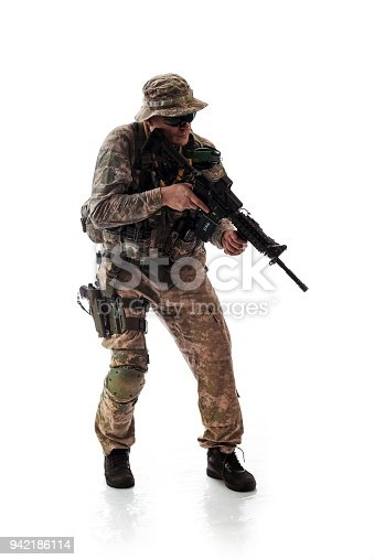 istock man in military outfit of the American trooper in modern times on a white background in studio 942186114