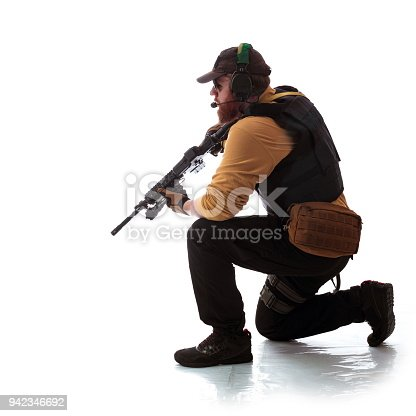istock man in military outfit Russian or American adviser in modern times on a white background in studio 942346692