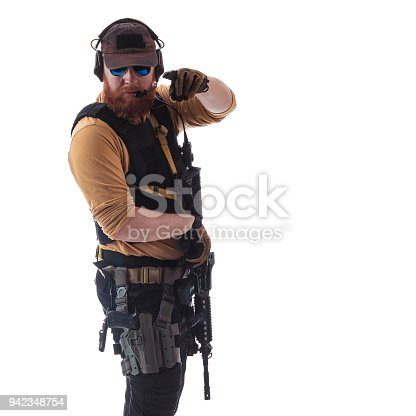 istock man in military outfit Russian or American adviser in modern times on a white background in studio 942348754