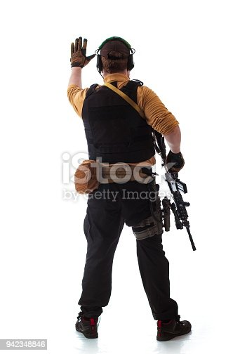 istock man in military outfit Russian or American adviser in modern times on a white background in studio 942348846