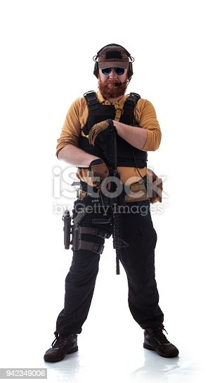 istock man in military outfit Russian or American adviser in modern times on a white background in studio 942349006