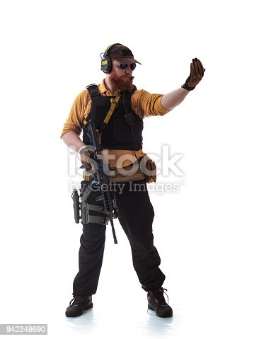 istock man in military outfit Russian or American adviser in modern times on a white background in studio 942349690