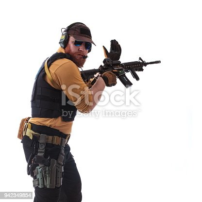 istock man in military outfit Russian or American adviser in modern times on a white background in studio 942349854