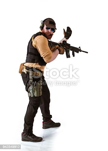 istock man in military outfit Russian or American adviser in modern times on a white background in studio 942349912