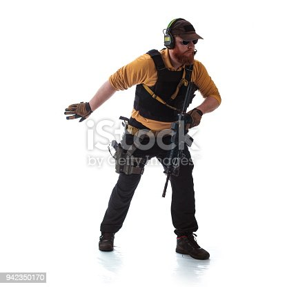 istock man in military outfit Russian or American adviser in modern times on a white background in studio 942350170