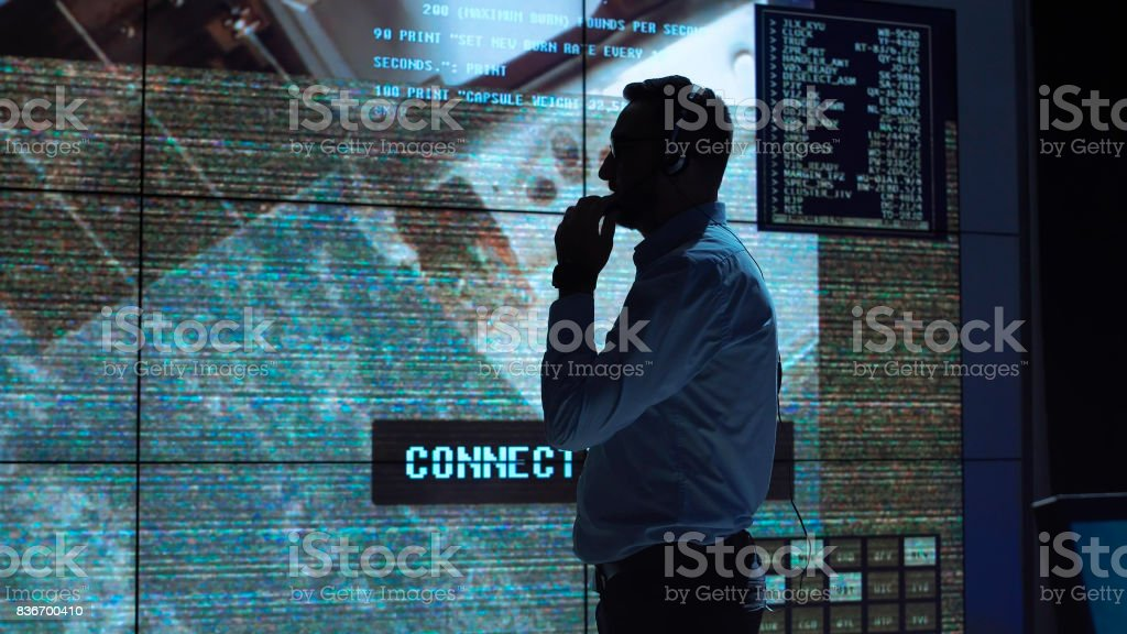 Man in mission control center stock photo