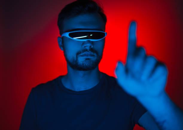 man in modern glasses touching air - vr red background imagens e fotografias de stock