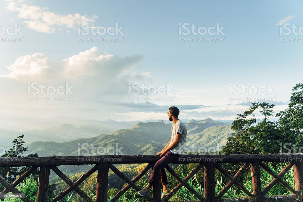 Man in mountains at sunset in Thailand - Photo